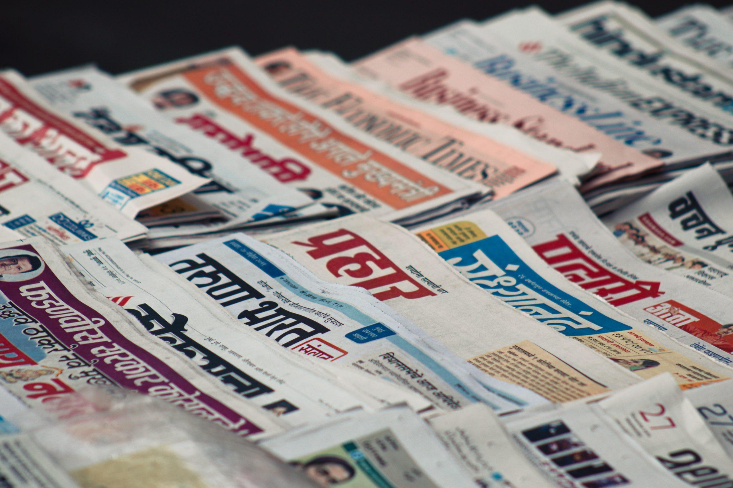 macro photography of assorted newspaper